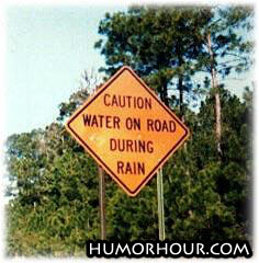 Caution, water on road!